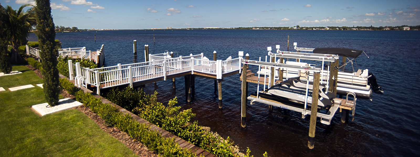 Azek Deck with Azek Railings and Hi-Tide Boat Lifts